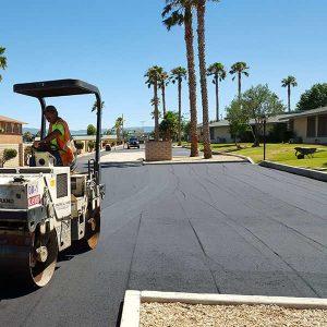 New asphalt parking lot being paved