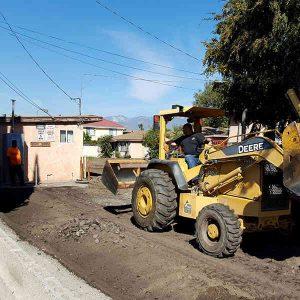 Crew repairing asphalt driveway