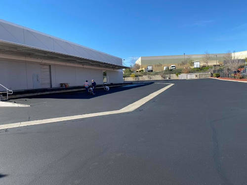 Commercial parking lot with new sealcoating done in Riverside County, CA