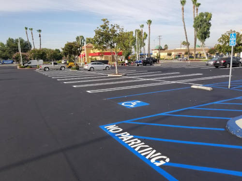 Parking lot with new ADA striping in place