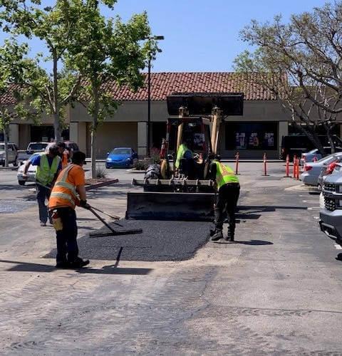 Asphalt parking lot being repaired in San Diego